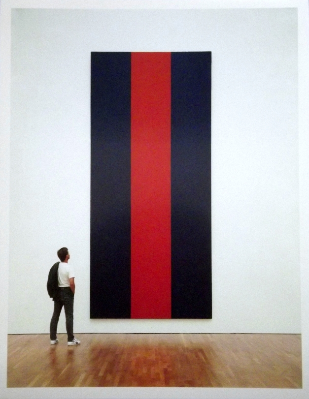 a man stands in front of a huge abstract painting