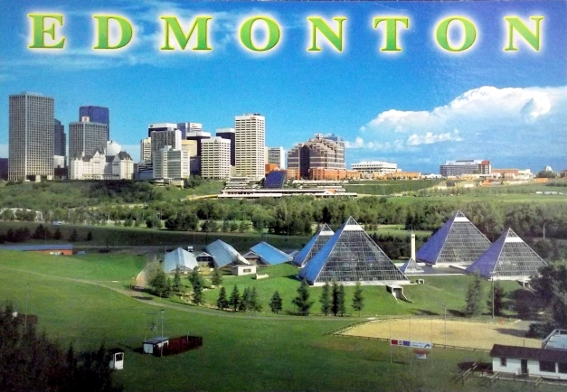An aerial view of Edmonton with some glass pyramids by a river