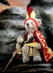 A teddy bear dressed as King Kamehameha