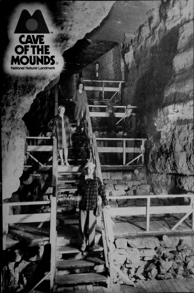 an old photograph of people in a cave