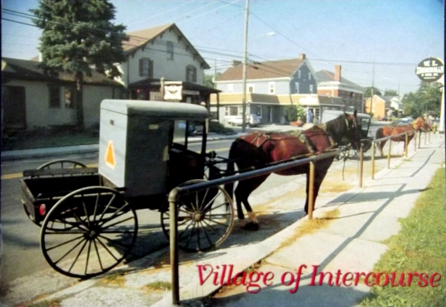 "A horse drawn carriage is shown with the caption of ""Village of Intercourse"""