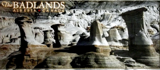 "A series of hoodoos with the caption ""Badlands Alberta"""