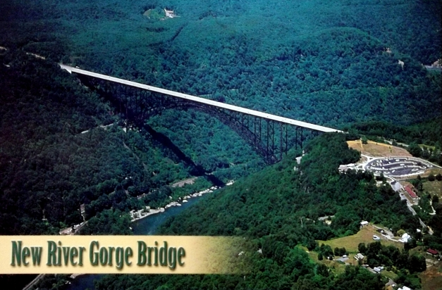 "View of a bridge across a bunch of trees with caption that says ""New River Gorge Bridge"""