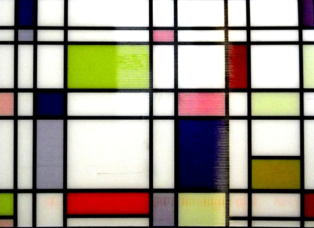 Modern art - a series of rectangles, some coloured blue or green
