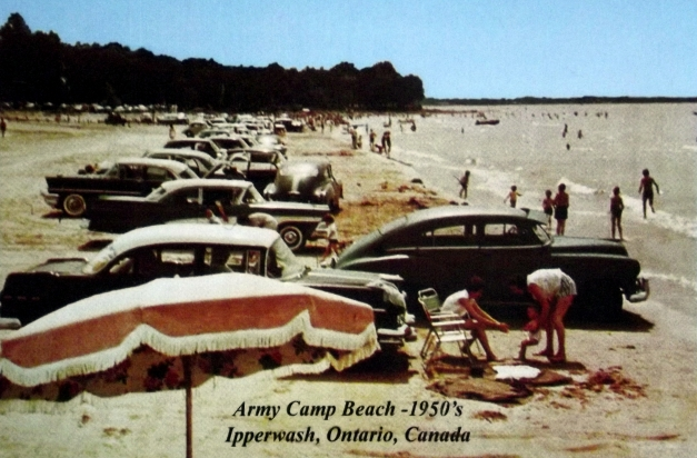 "1950s era cars are parked on a beach with the caption ""Army Camp Beach - 1950s, Ipperwash, Ontario."""