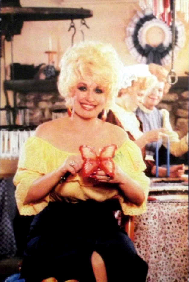 Picture of Dolly Parton with a butterfly candle