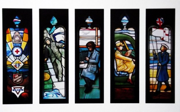 Stained glass window showing scenes with soldiers