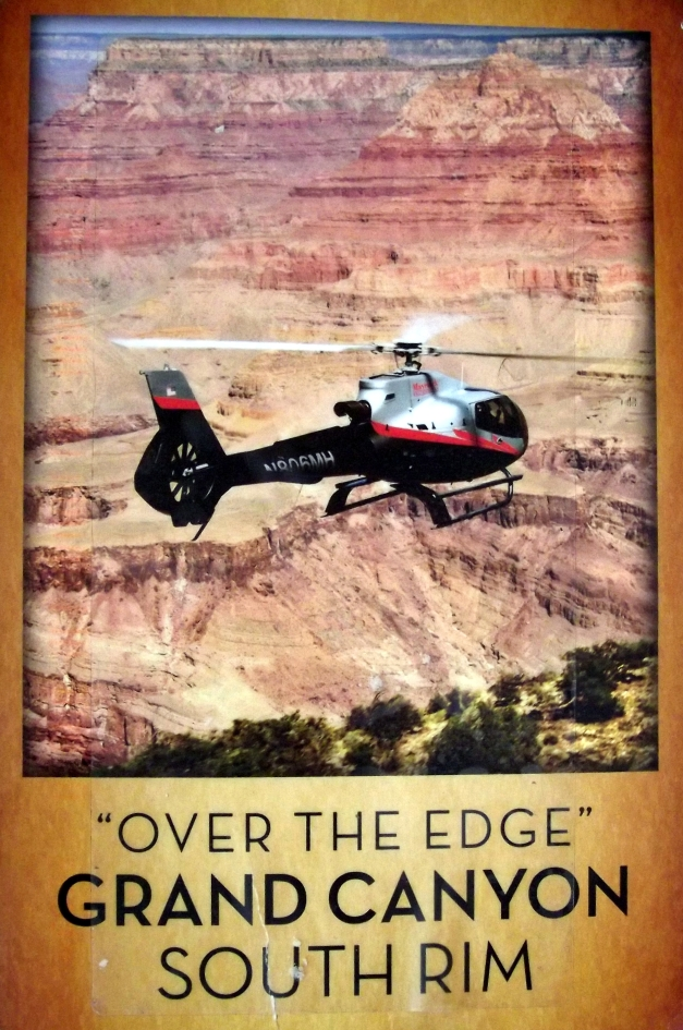 "Picture of a helicopter flying over the grand canyon with the caption ""Over the edge Grand Canyon South Rim"""
