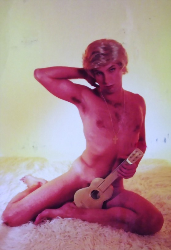 A naked German man poses with a ukulele