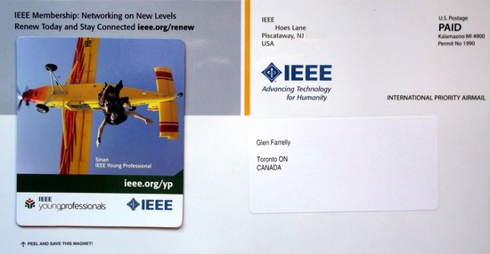 Postcard promoting membership to IEEE with a detachable fridge magnet