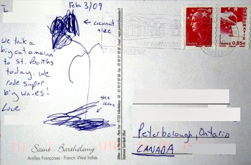Reverse side of postcard with a child's drawing on it