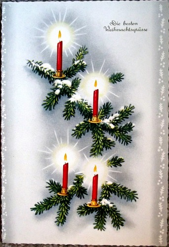 Pictures of candles on an evergreen