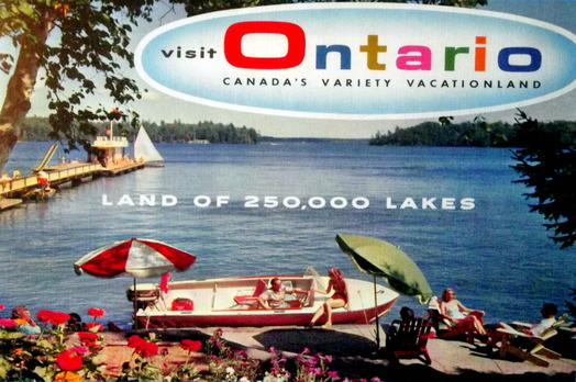 "1950s era image of a people on the deck with their boat by a lake and the caption ""Visit Ontario land of 250,000 lakes"""