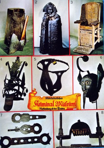 Various different old torture devices with the caption Kriminalmuseum in Rothenburg ob der Tauber