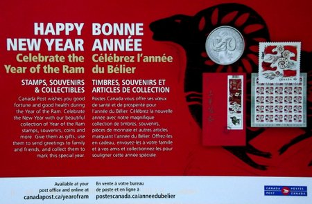 Postcard showing Ram themed stamps and coins for the Chinese Year of the Ram