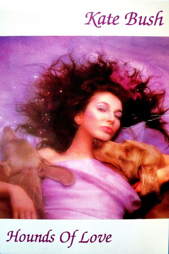 Photo of Kate Bush with two dogs