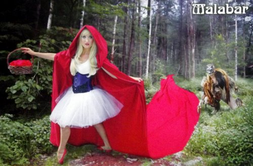 Woman dressed as Little Red RIding Hood and man dressed as the wolf