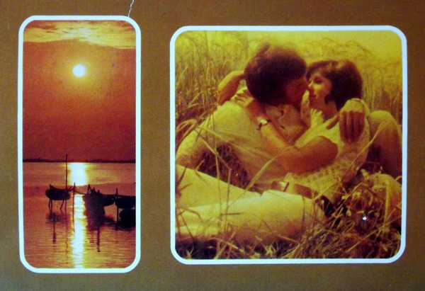 Postcard from 1970s featuring two images. One of an ocean sunset and another of a couple kissing.