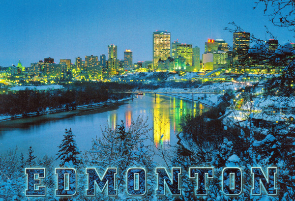 Winter Skyline of Edmonton at night with highrises in the back and the North Saskatchewan river in front