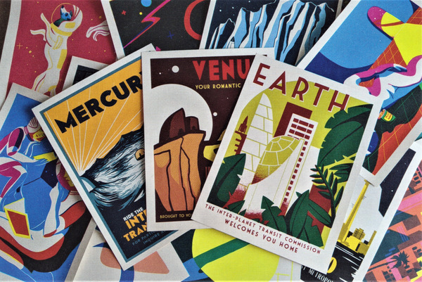 A spread of postcards with images and captions of various planets