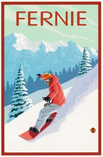 A man snowboards down a snowy slope with snow-covered mountains in the distance