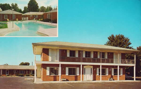 A photo of a red-brick motel circa 1960s or 1970s.
